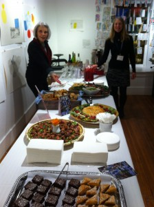 Board members Flo Larson and Polly Prindle-Hess put the finishing touches on the refreshments provided by Maura's Cafe.